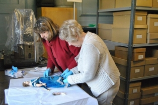 museum-volunteers-cleaning-a-doll