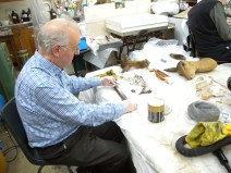 Rowell cleaning silverware in the lab