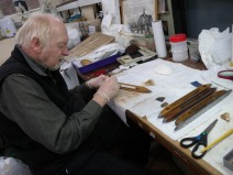 """Ray cleaning some shuttles from the """"South Kensington Museum"""" now the V and A. The handwriting on the card is by Dr Henslow, one of the first curators of Ipswich Museum and Darwin's Tutor"""