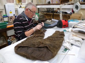 Geoff cleaning an Ivenki costume from the east of Russia, about 150 yrs old